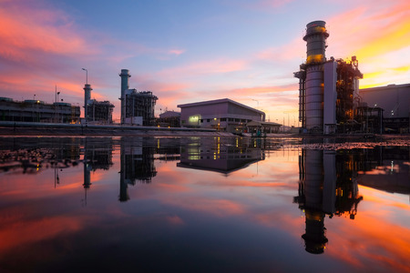 Combined cycle power plant against twilight sky