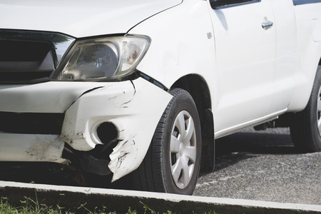 Man photographing his vehicle with damages for accident insurance