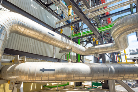 Piping and equipment in combine cycle power plant with metal tone Stock Photo