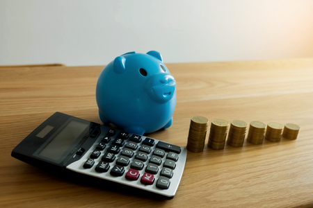 The blue piggy bank with business ,save money .finance concept .