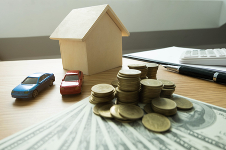 Close up object Money exchange with real estate. Contract on trading a car and house concept.