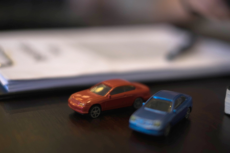 Close up object  insurance car concept. insurance car with clip board, note book, pen and documents on working table. Stok Fotoğraf