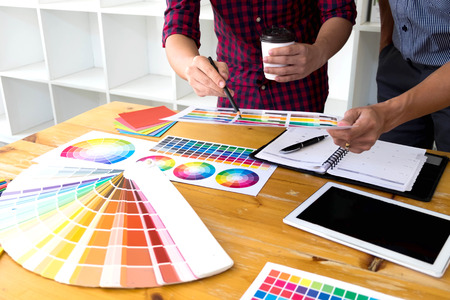 Graphic designers choose colors from the color bands samples for design .Designer graphic creativity working concept .