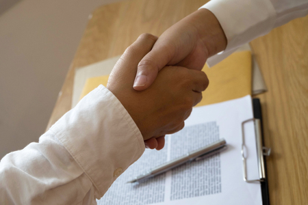 Lawyer handshake. Lawyer people shaking hands with client, finishing up a meeting,Success agreement negotiation. Reklamní fotografie