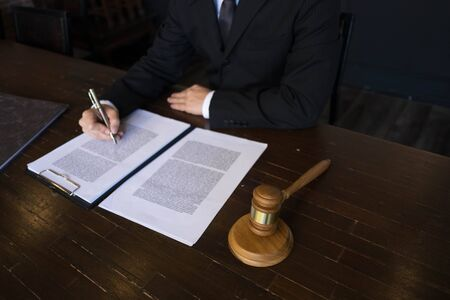 Lawyer working with contract papers on the table in office. consultant lawyer, attorney, court judge, concept. Stok Fotoğraf