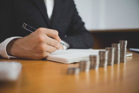 Businessman working with income statement document on the wood table.Business concept. 写真素材