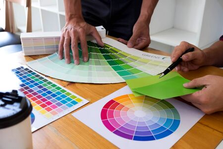 Graphic designers choose green tones from the color bands to design ideas, creative designs, graphic designers.