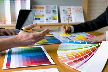 Graphic designers choose colors from the color bands samples for design .Designer graphic creativity work concept .