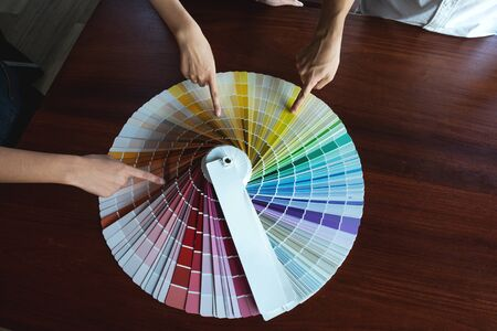 Graphic designers choose colors from the color bands samples for design .Designer graphic creativity working concept.