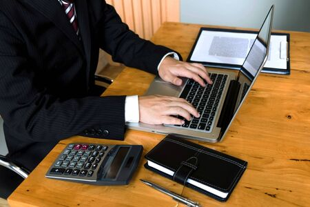 Businessman using laptop to the situation on the market value , Business concept Stock fotó