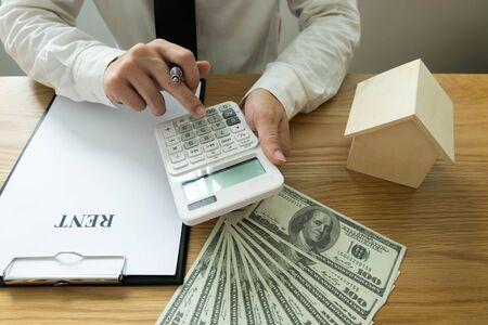 Businessman calculates buy - sale price house . Agent sale home insurance. business concept. Stock fotó