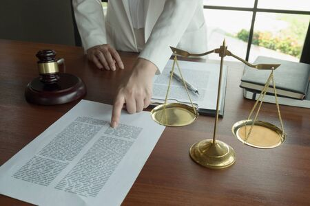 Lawyer working with contract papers on the table in office. Stock fotó