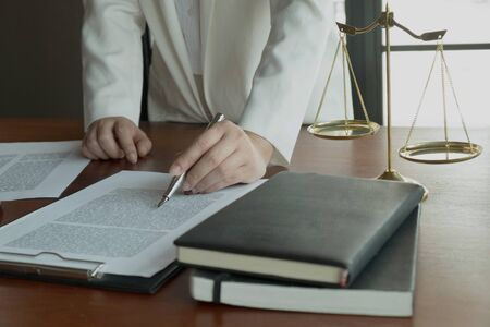 Lawyer working with contract papers on the table in office. consultant lawyer, attorney, court judge, concept. Stock fotó