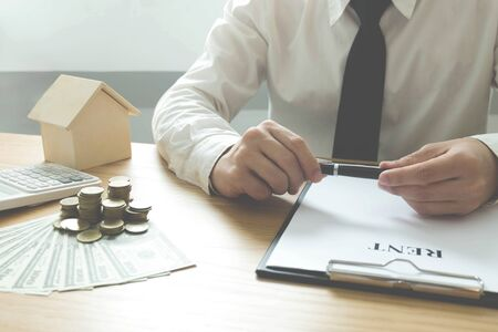 Businessmen contract on trading - rent a house.