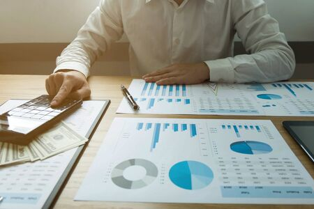 Businessmen calculate earning business performance, business concept .