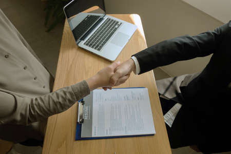 Business handshake. Business people shaking hands, finishing up a meeting,Success agreement negotiation. Stock fotó
