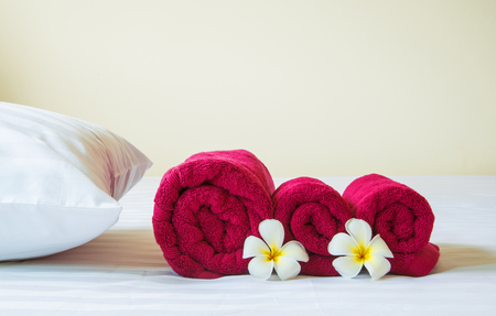 luxury hotel room: Well prepared in hotel bed with Frangipani flowers