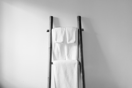 white towels: Towels hanging on the bamboo hanger and ready to use