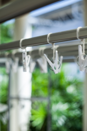 lugworm: white plastic clothespins with metal spring Stock Photo