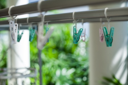 metal spring: Green plastic clothespins with metal spring