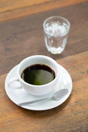 Hot Cup of Coffee on a Wooden Table photo