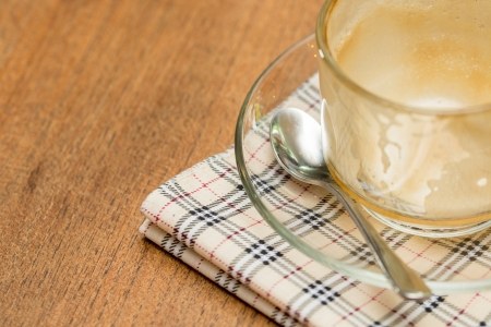 Coffee cup on a wooden table photo
