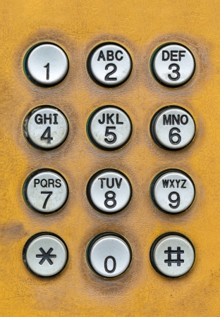 dial pad: old dial pad of public telephone box, close up