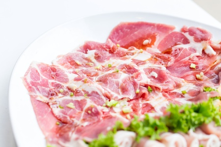 freshness slided pork on white dish for grill photo