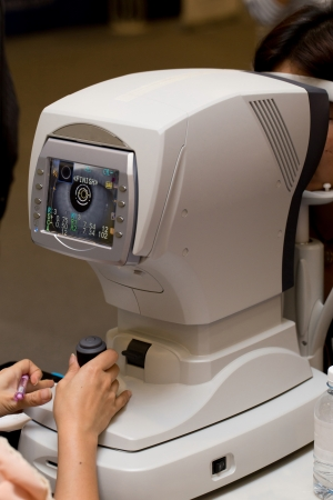 medical attendance: Male patient is having a medical attendance at the eye measuring Stock Photo