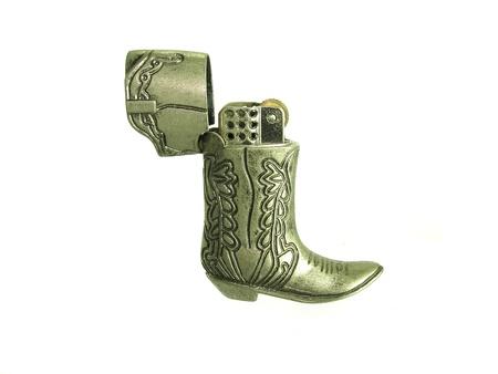 gas lighter: metal boot zippo lighter Stock Photo