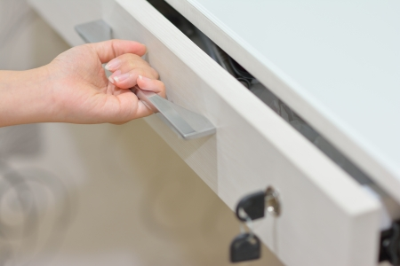drawers: one hand opening white drawer