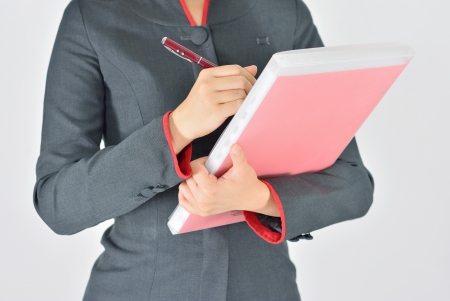 Business woman hand writing notes on notepad