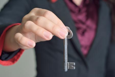 woman hand giving key