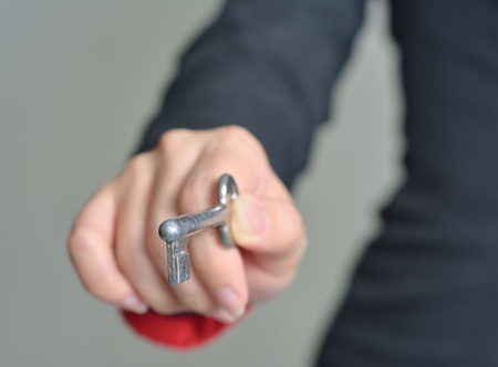 female hand with an old key  photo