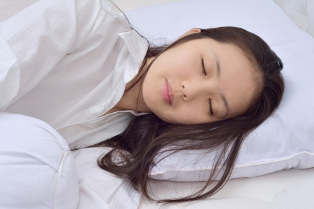 sleeping face: woman sleeping on her bed at home Stock Photo