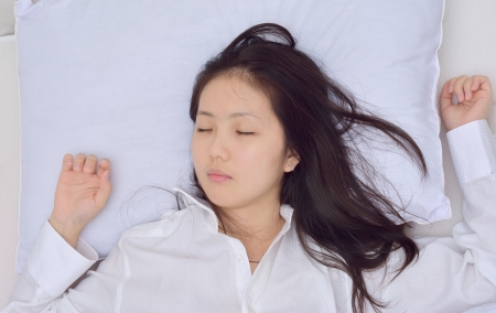 woman too tired fall a sleep on her bed  photo