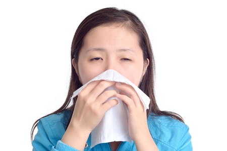 woman sneezing in a tissue, isolated on white background Standard-Bild