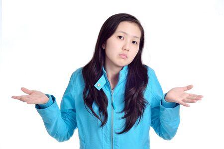 shrugs:  girl shrugs her shoulders isolated on white background