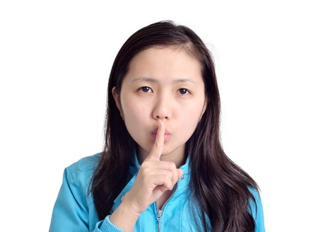 woman making a hush gesture isolated on white background