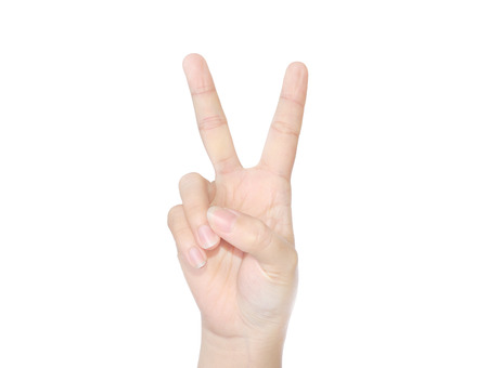 female hand with victory sign isolated on white photo