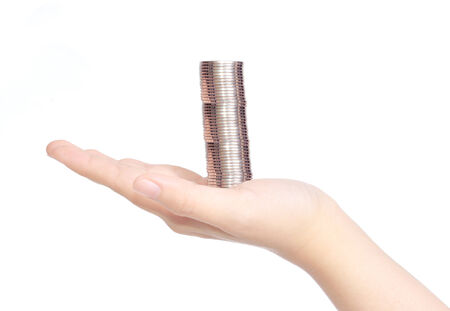 stack of coins on female hand  isolated on white background Standard-Bild