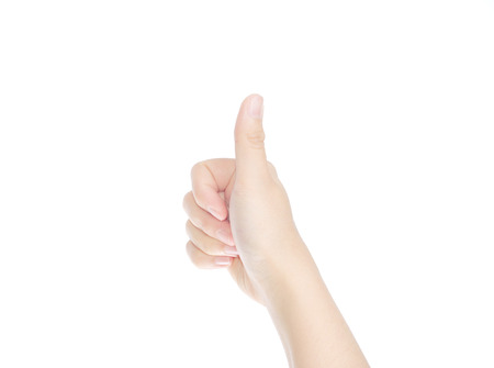 female hand showing thumbs up sign isolated on white background Standard-Bild