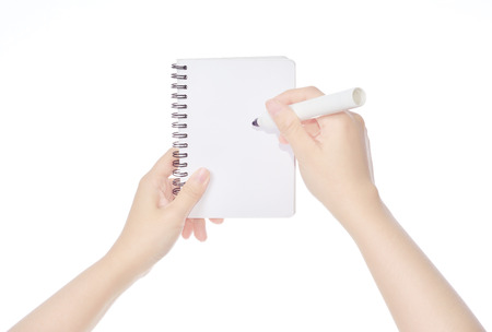 female hand writing on notebook  isolated on white