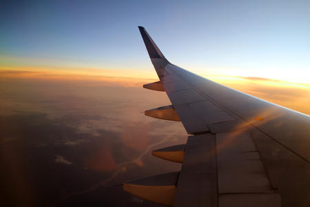 Morning sunrise with Wing of an airplane Standard-Bild
