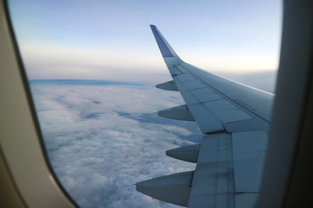 View from an aeroplane windows with an airoplane wing in the corner Stock Photo