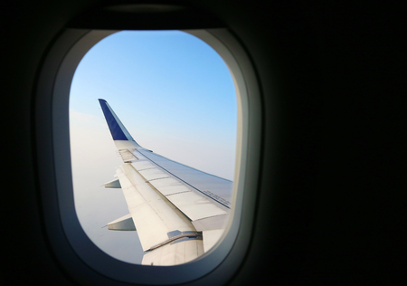 View from an aeroplane windows with an airoplane wing in the corner Standard-Bild