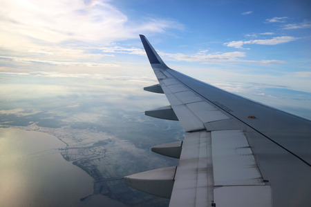 View from an aeroplane windows while landing with an airoplane wing in the corner Standard-Bild