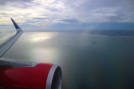 View from an aeroplane with an airoplane wing in the corner