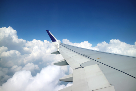 Arial view from internal cabin of aeroplane. View with wing of aeroplane in image Standard-Bild