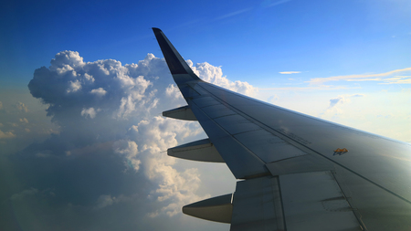 beautiful cloudy blue sky view from commercial airplane windows